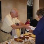 David Green, warden, serves at the cake and pastry stall.